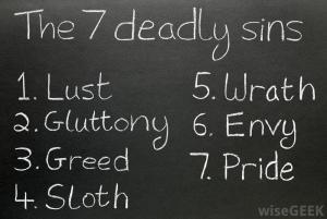 list-of-the-7-deadly-sins-on-a-chalkboard